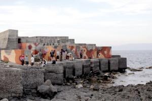 Un intervento sul molo foraneo di Naxos