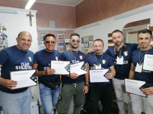 Carmelo Giuffrè (secondo da destra) assieme ad alcuni colleghi del  Team di lavoro